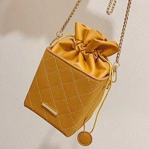 Mini drawstring bag (purse)